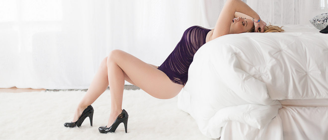 folsom boudoir photography draped on bed