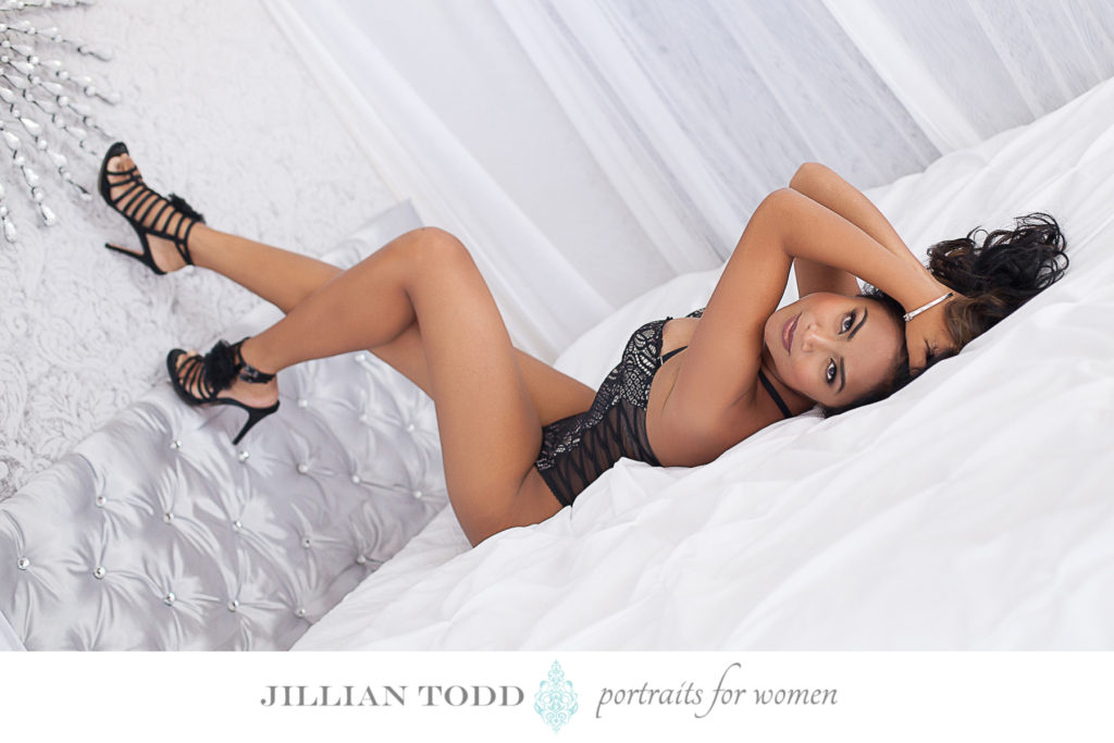 Granite-Bay-boudoir-photo-of-brunette-woman-on-white-bed