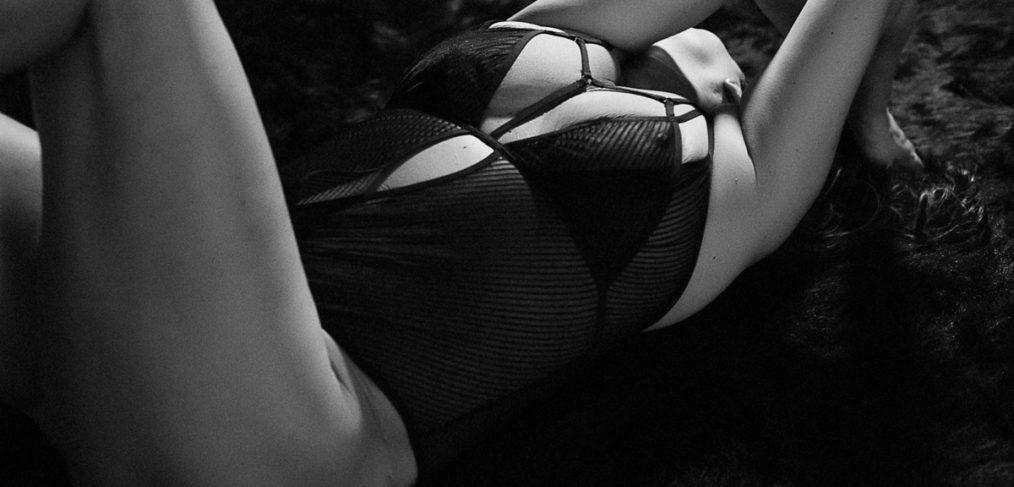 brunette woman in black bodysuit by roseville boudoir photographer