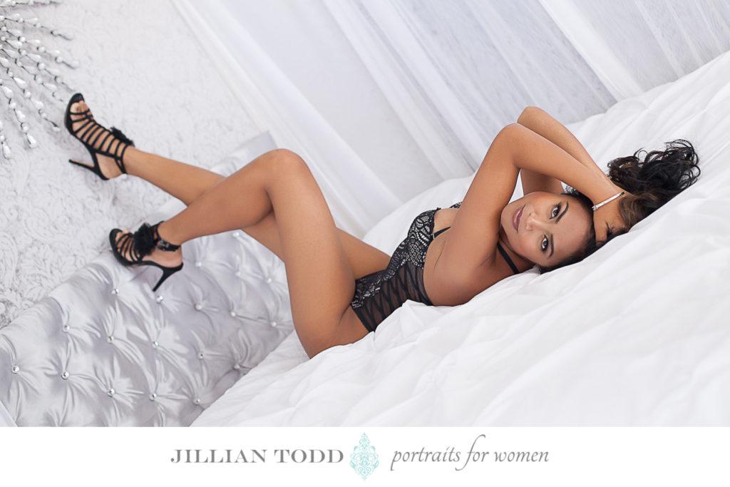 Granite-Bay-boudoir-photo-of-brunette-woman-on-white-bed